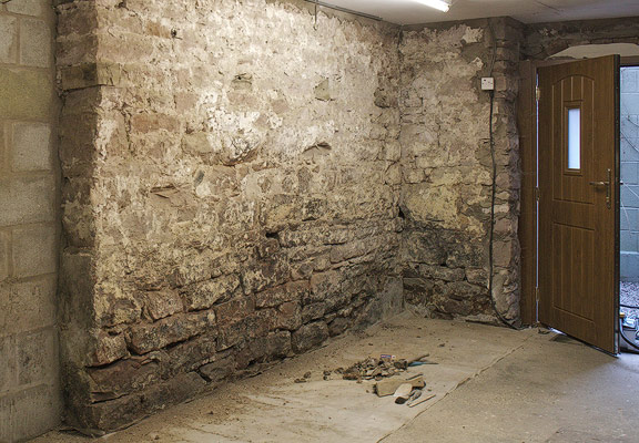 rising damp caused by non-breathable concrete floors