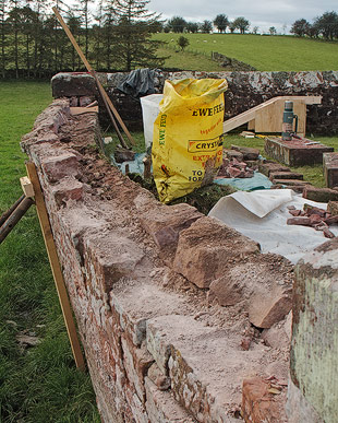 retaining wall built in red sandstone and lime mortar - dismantling prior to rebuilding using lime mortar