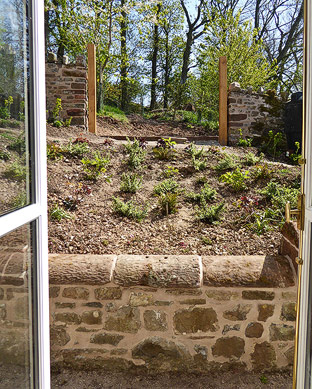 lime mortared retaining wall and rubble boundary wall