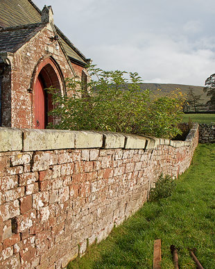 leaning retaining wall built in red sandstone and lime mortar - Murton, near Appleby, Cumbria.