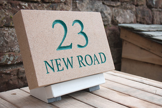 traditional hand-carved house number sign, made in Cumbria.